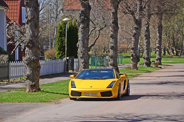 A Lamborghini luxury car driving on the street