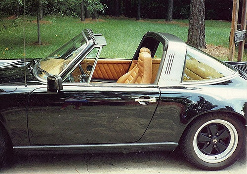 A Porche convertible showing perfectly maintained, hand-stiched leather upholstery