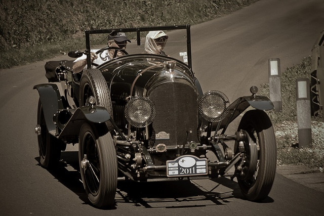 A classic luxury car showing superior craftsmanship and charisma
