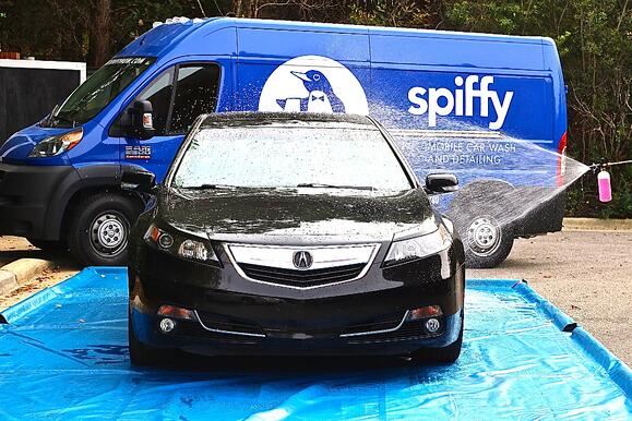 Acura being washed by Spiffy