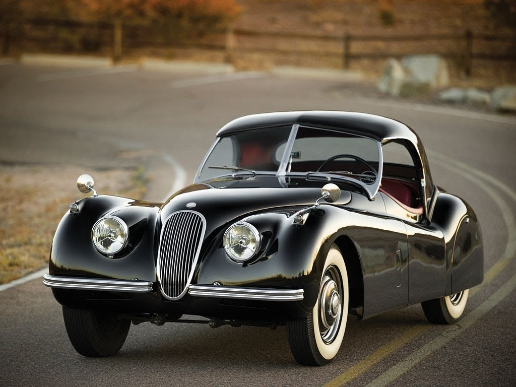 A beautiful vintage car hugging the road
