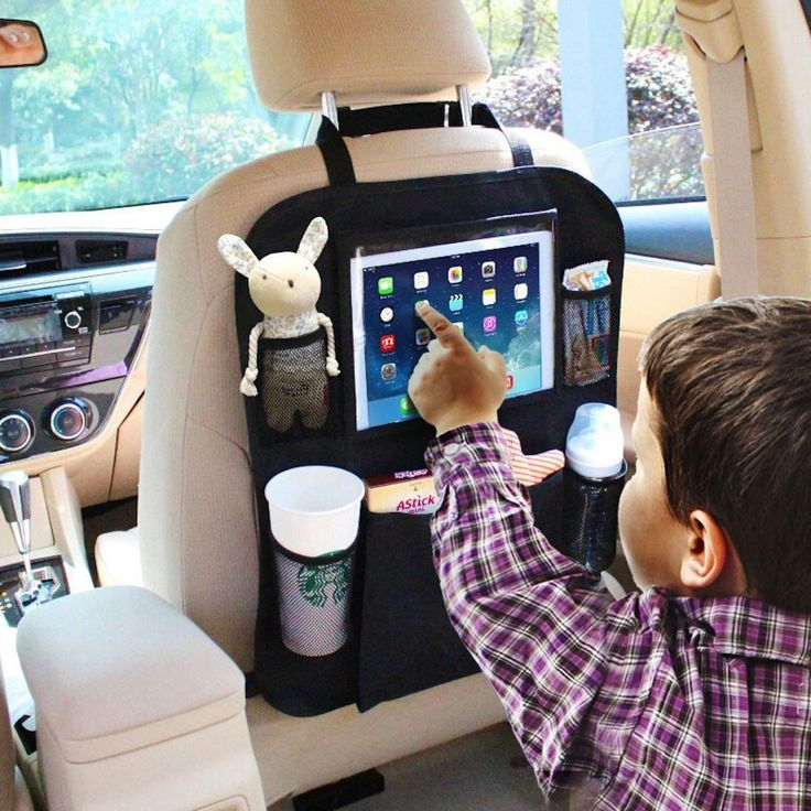 Child in carseat playing on Ipad in the car