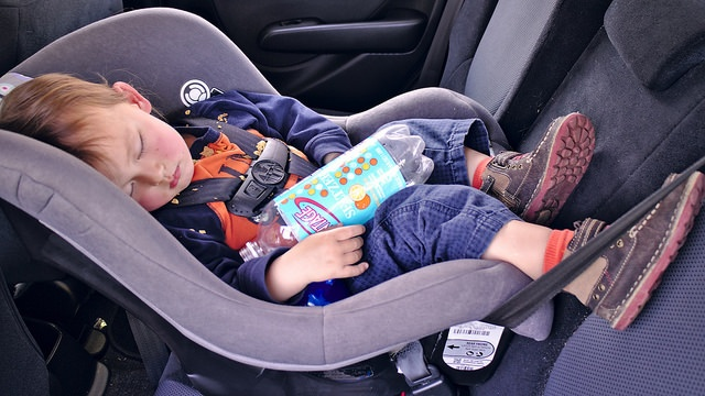 Baby sleeping peacefully in a car seat
