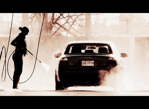 Dirty car getting a high pressure exterior wash