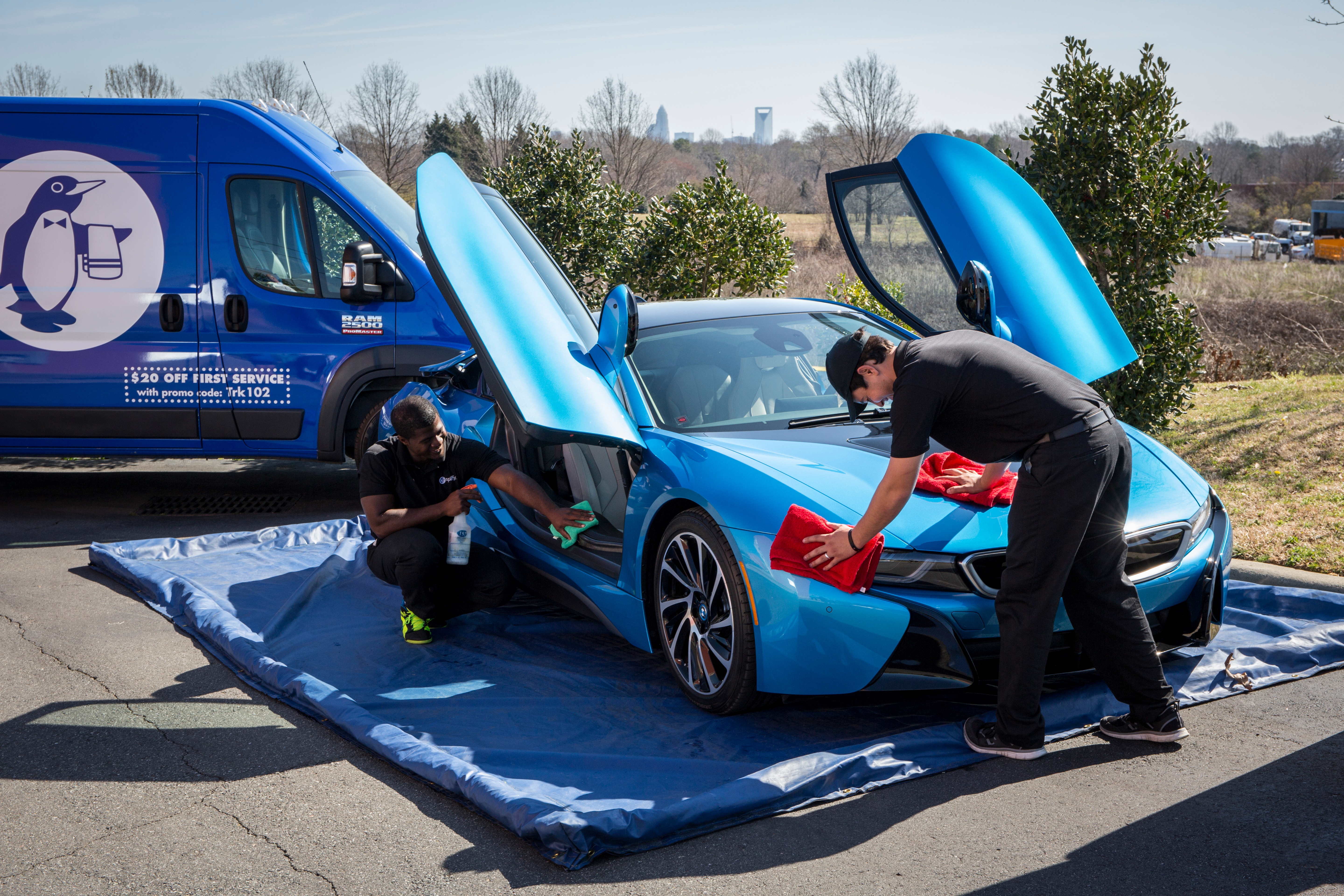 Spiffy Technicians on-site detailing luxury vehicle